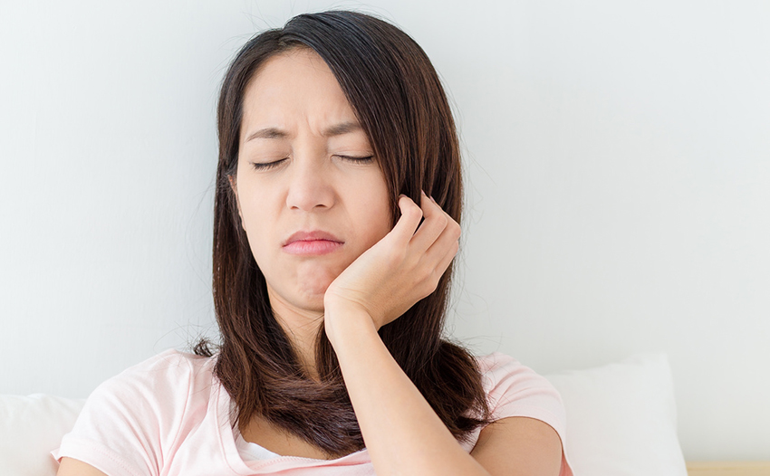 Woman with jaw pain and lack of sleep